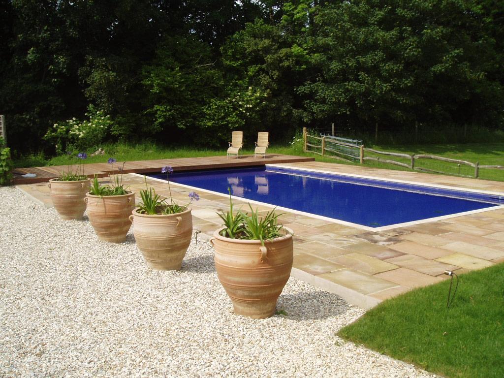 Piscine en plein air de luxe de style classique dans le Surrey