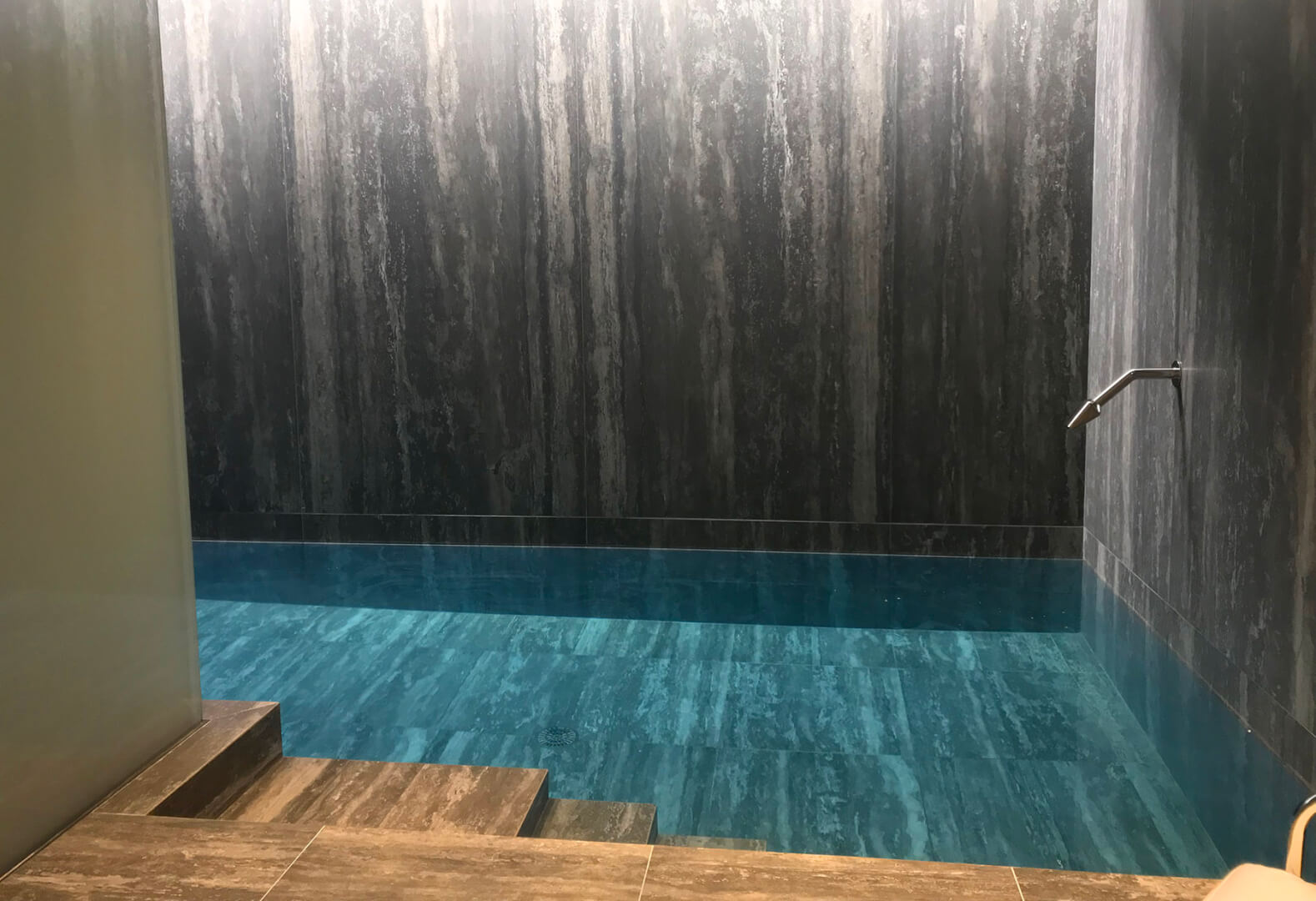 Tranquil indoor swimming pool with luxury neck massagers