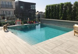 out door swimming pool surrounded with wooden flooring
