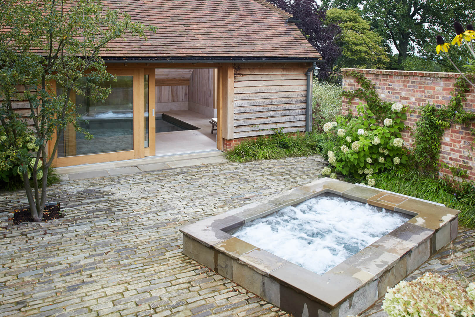 Outdoor spa pool by Guncast