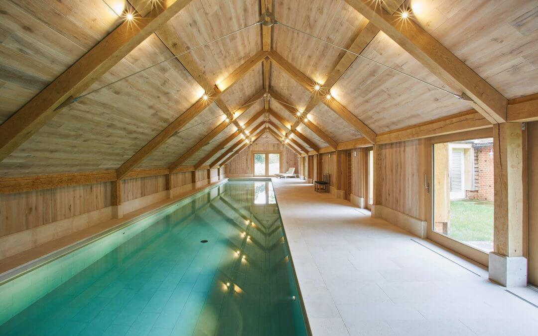 Striking Guncast indoor pool for exercising in luxury home